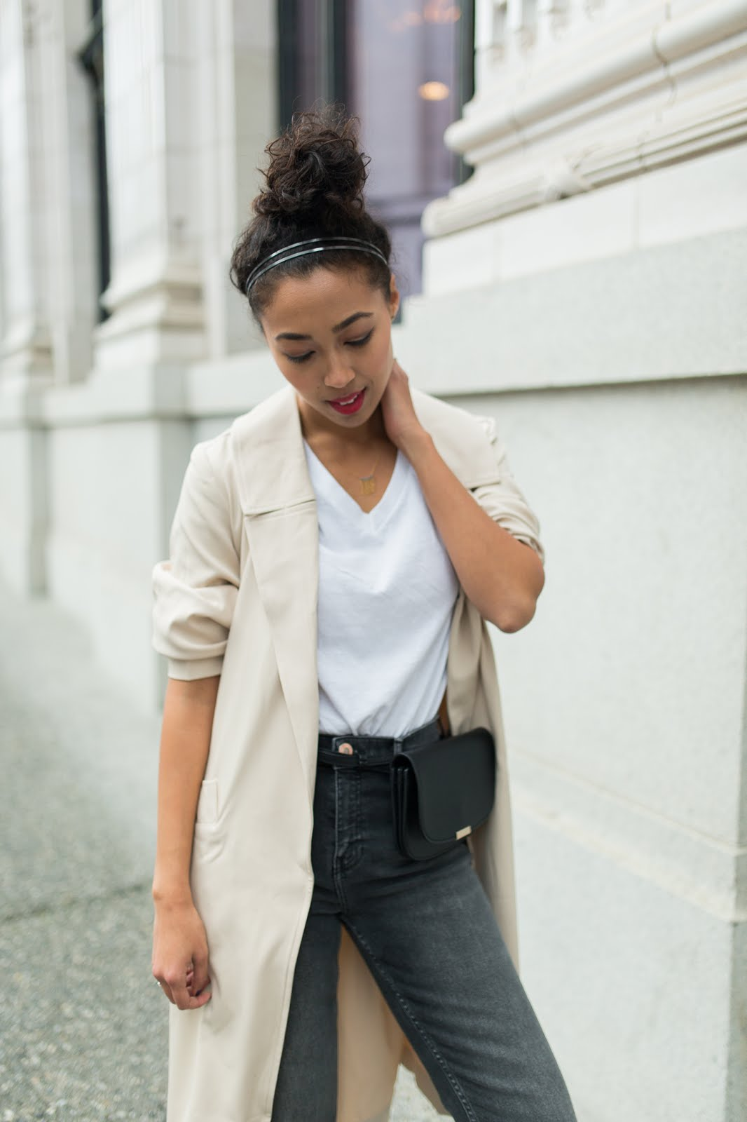 pancake stacker wearing a Two Feathers trench coat, River Island straight leg jeans; Everlane black oxfords, a white tee, and a Zara fanny.