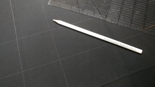 Water soluble white pencil on Island Batik solid black fabric