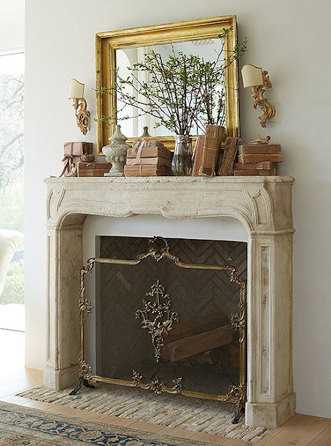 Beautiful modern farmhouse fireplace at Patina Farm...decor inspiration on Hello Lovely Studio
