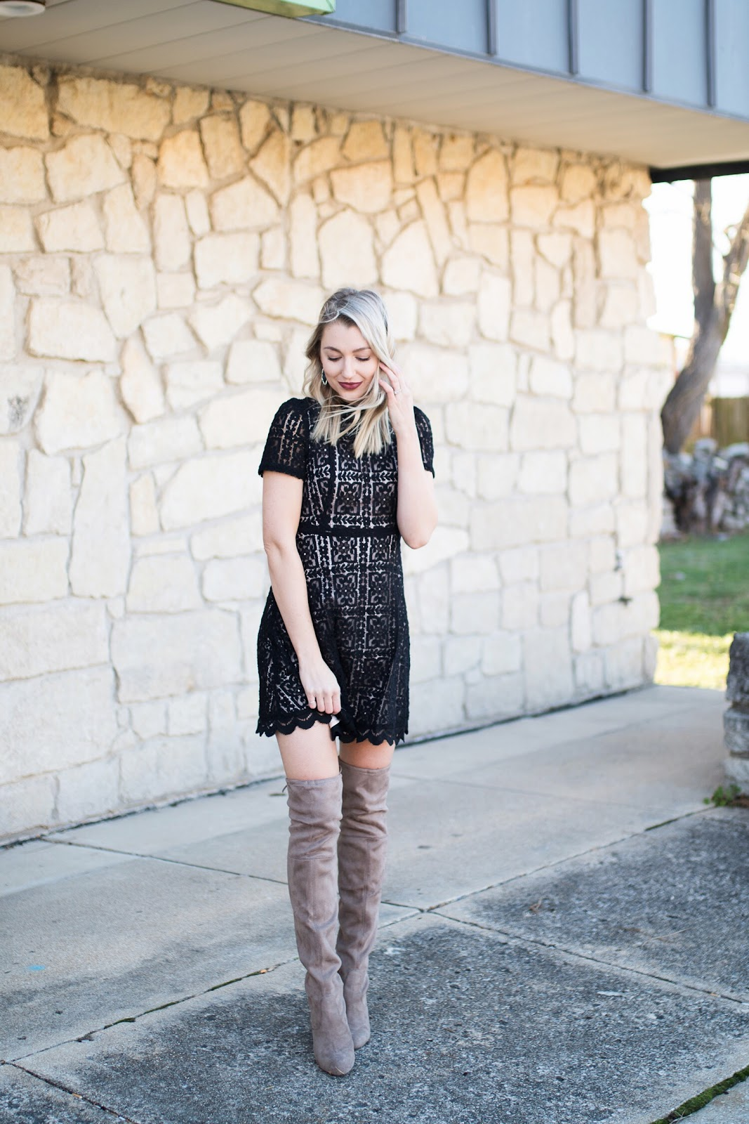 Holiday dress with over-the-knee boots