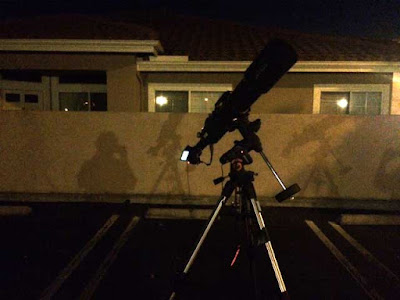 City lights bright enough to show shadow of astronomer