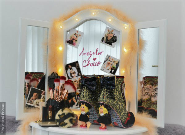 dressing room table with mirror and lights and Irregular Choice Disney Muppets leopard print boots