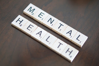 Image of Scrabble Tiles spelling the words mental health