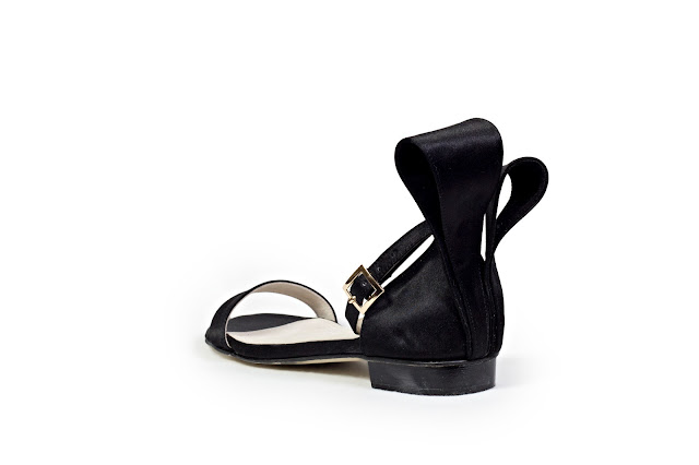 Black satin textured flats with origami bow at the back