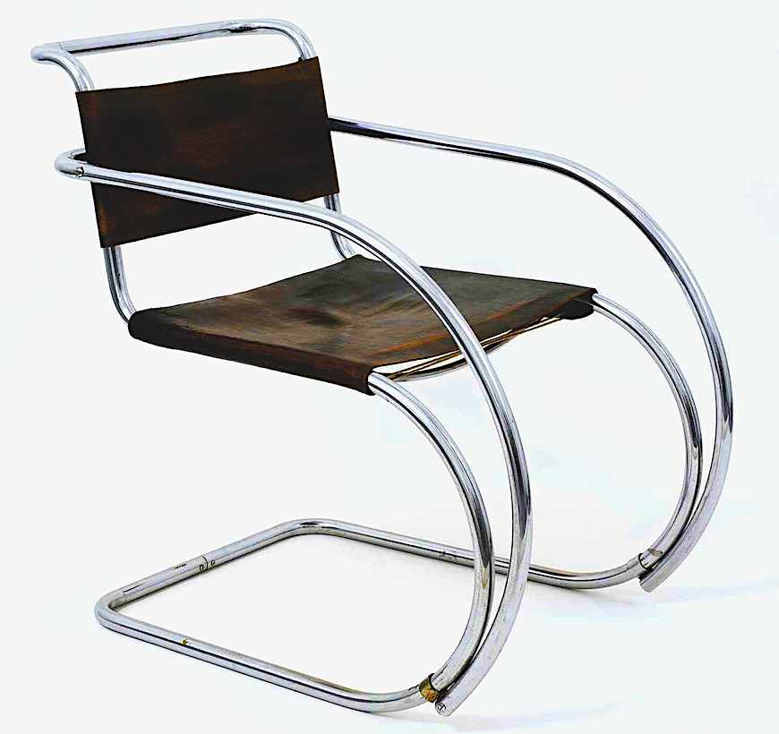 a color photograph of A 1928 chair by architect Mies van der Rohe