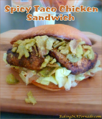 Spicy Taco Chicken Sandwiches are a lunch with a kick. Grilled Taco Chicken, melted pepper jack slathered with chipotle dressing and topped with crunchy jalapenos. | Recipe developed by www.BakingInATornado.com | #recipe #sandwich