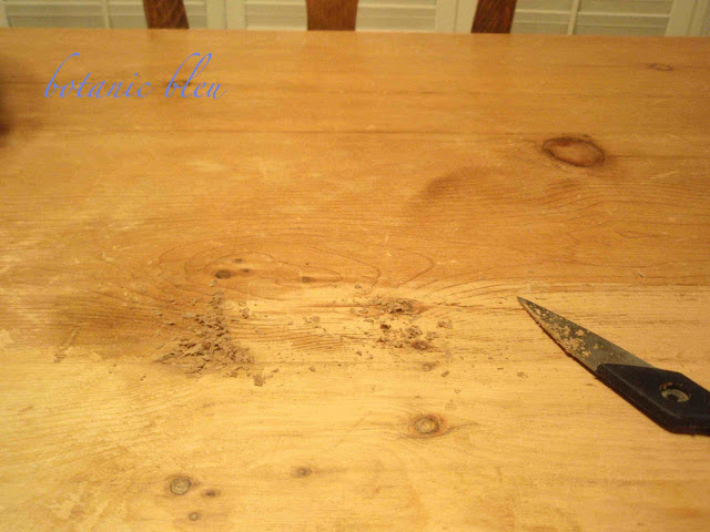 Old wax was scrapped from a table made from old reclaimed English pine boards