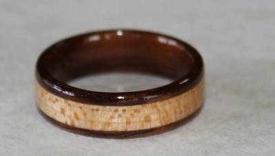 Dark Hawaiian Koa wood ring with a Cottonwood inlay