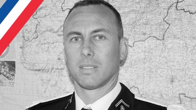 Hero French police officer who traded places with hostage dies
