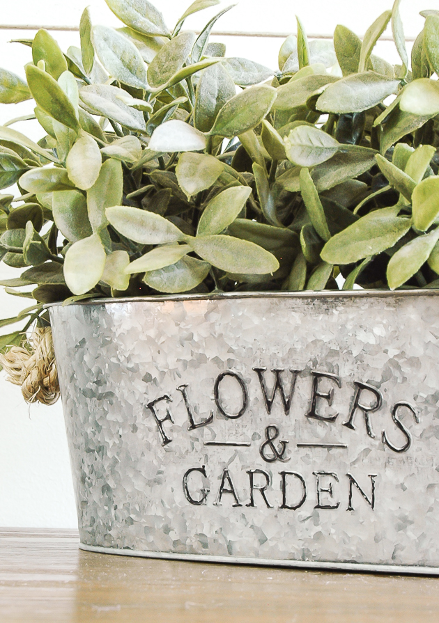 Use household ingredients to give shiny metal Dollar Tree planters an aged look