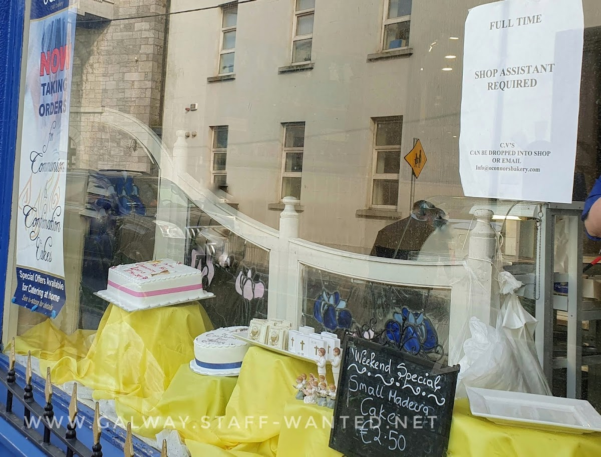 Cake shop window - job ad and weekend special:  small Madeira cake for €2.50