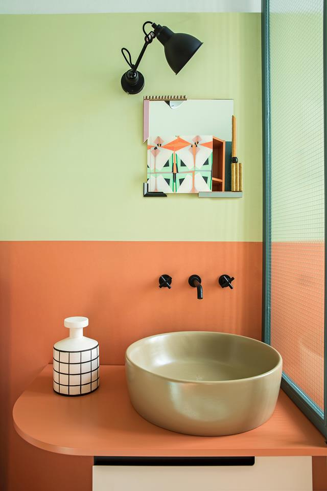 "In the colourful bathroom, the basin is by Ceramica Globo, the taps are from Life by Bellosta, the wall and floor resin was by Rezina, the wall lamp is by Lampe Gras DCW Editions and the custom-made cabinet is by Marcante Testa, decorated with ""Temporary Tapestry"" wallpaper by Thomas Voorn.y- design addict mom"