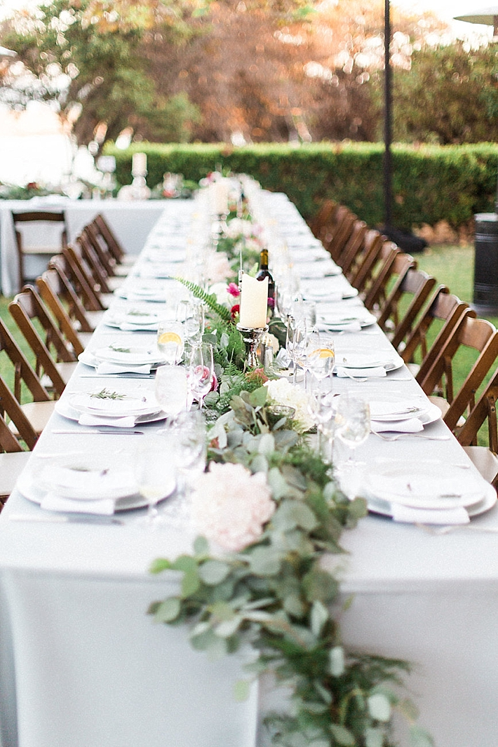 Long rectangle reception table with floral runner and candles | Photo by Matoli Keely Photography