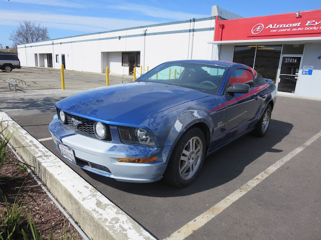 Car suffered minor cosmetic damage during test drive. We fixed damage and repainted.