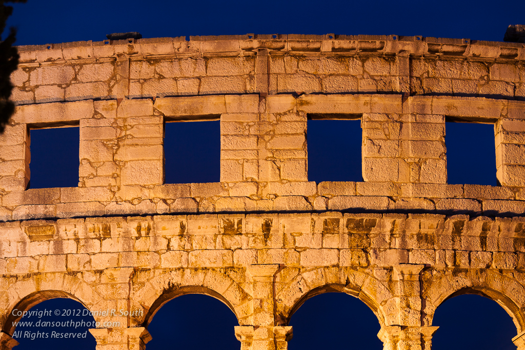 a photo of a roman amphitheater at pula croatia by daniel south