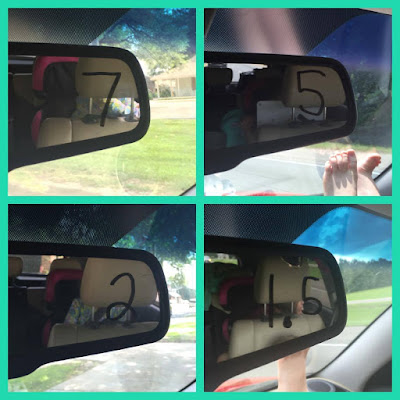 Rear view mirror with decimals written in dry erase marker