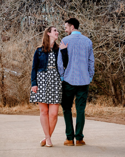 a great photo of an engaged couple in Boulder Colorado looking towards each other for their photography session