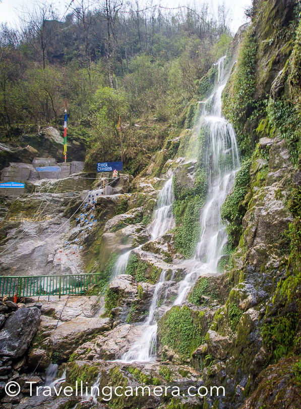 There are several magnificient waterfalls in Sikkim and the Seven Sister waterfall is one of them. Located around 32 kilometers from Gangtok, this waterfall is easily accessible from the Gangtok-Lachung highway. When we drove past these waterfalls, it was still summer and the water was comparatively less, but it is said that during the rains, these waterfalls are a sight to see.   From a distance from certain points each of the seven different waterfalls is visible, falling almost parallel to each other, down the rugged face of the mountain. Some of the falls turn to almost a trickle in the summer, while others hide behind the rocks, but overall, the falls are worth a stop and some photos even at the driest times.   During monsoon, you can spend more time here. Anyways, we feel Sikkim is a place you should go with loads of time on your hands, because there's a risk that you will fall in love with a small town or a city and would want to spend more time there. We tried to be flexible during our trip and it works.   When we were on our trip, we met several people simply because we were riding the public transport most of the time. Among the people we met was a Russian national who had taken up a job in Infosys in Hyderabad and had been staying here for several years simply because he wanted to see India and what could be better if you could do it while getting paid well. Sikkim is the ideal place for such a guy, because he takes long vacations from his company and usually visits a place with the intention of exploring it. He had arrived in Gangtok and rented a very cheap hotel so that he could stay longer. And he would plan each day as it came.   It is these kinds of people who would get the most from visiting a place like Sikkim. But a majority of tourists in Sikkim are families. We found several of them at Seven Sister Waterfalls as well. They usually come here on a tight schedule and leave after the quintessential selfies with their feet dipped in the pool. Nothing
