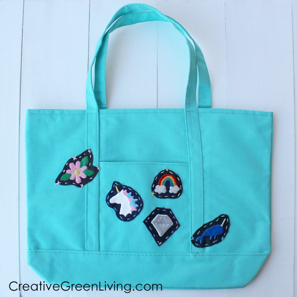Tutorial: How to make patches. Learn how to make simple DIY patches by hand to sew or glue onto a totebag or backpack. This is a great way to use up fabric scraps or recycled jeans. #creativegreenliving #recycledjeans #oldjeans #patches #DIYpatches #puffypaint #dimensionalpaint #patchwork #recycledcrafts #upcycling