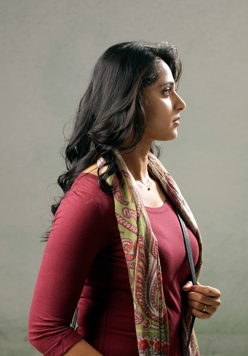 Actress Anushka shetty Sad Photos In Maroon Top Green Skirt