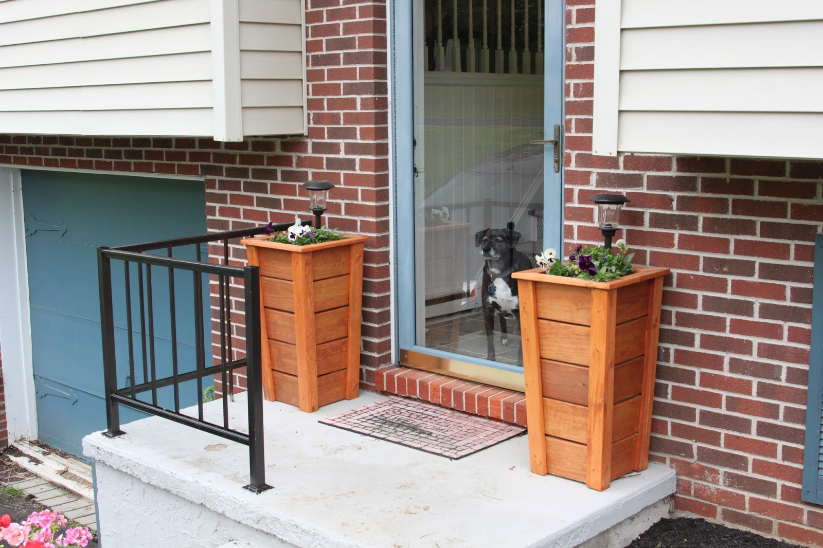 I have made planters a few times before which you can see here and here but these tall skinny ones fit perfectly on either side of our front door