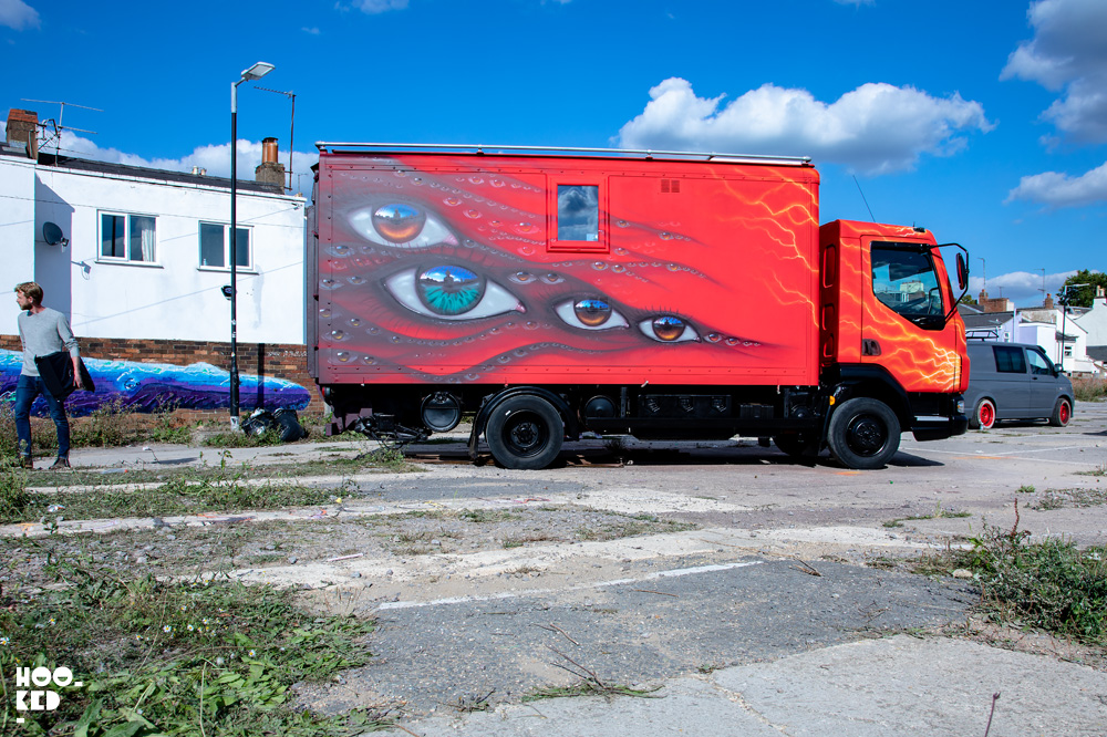 Final images of red van decorated with eyes by Street Artist My Dog Sighs