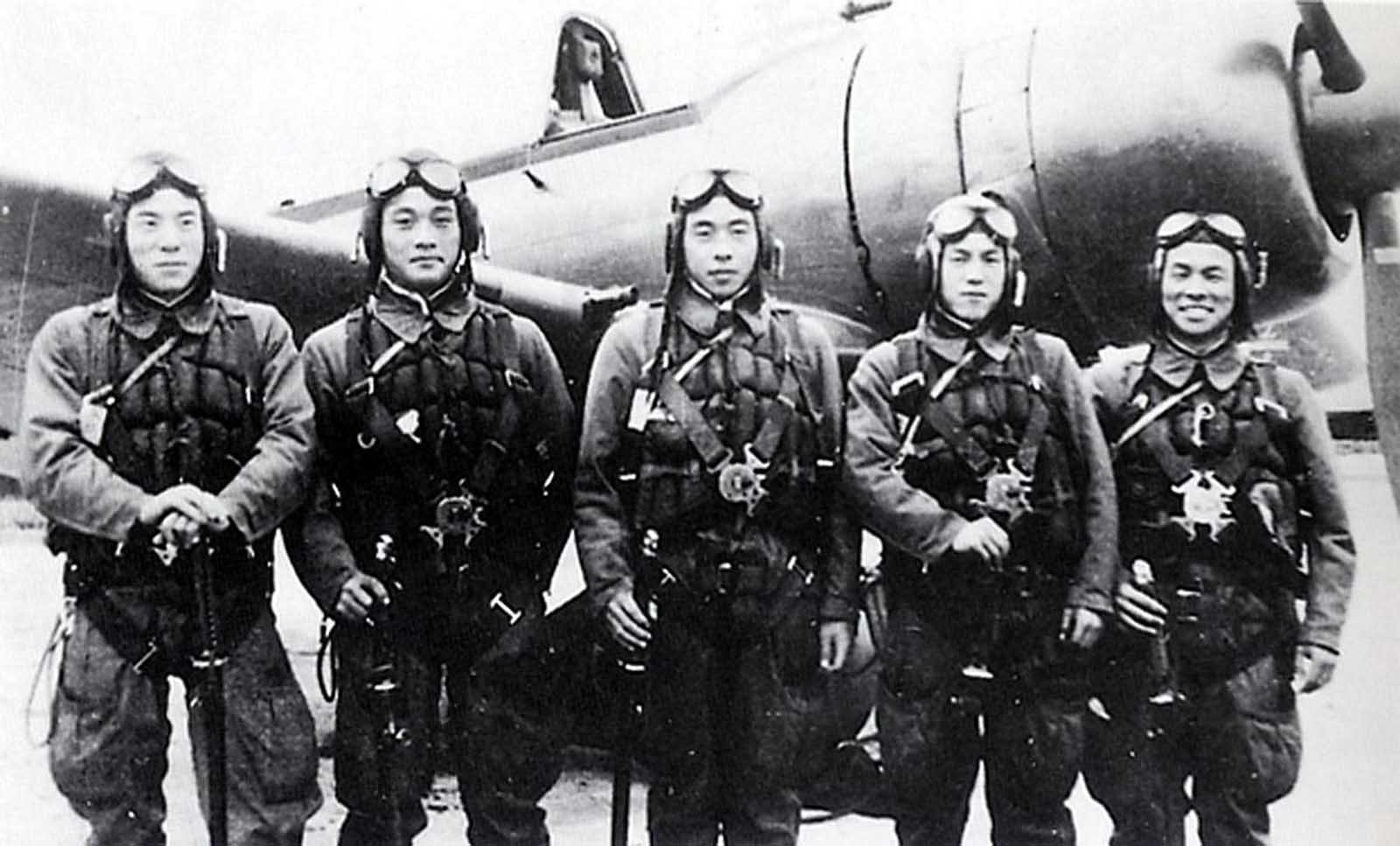 This photo provided by former Kamikaze pilot Toshio Yoshitake, shows Yoshitake, right, and his fellow pilots, from left, Tetsuya Ueno, Koshiro Hayashi, Naoki Okagami and Takao Oi, as they pose together in front of a Zero fighter plane before taking off from the Imperial Army airstrip in Choshi, just east of Tokyo, on November 8, 1944. None of the 17 other pilots and flight instructors who flew with Yoshitake on that day survived. Yoshitake only survived because an American warplane shot him out of the air, he crash-landed and was rescued by Japanese soldiers.