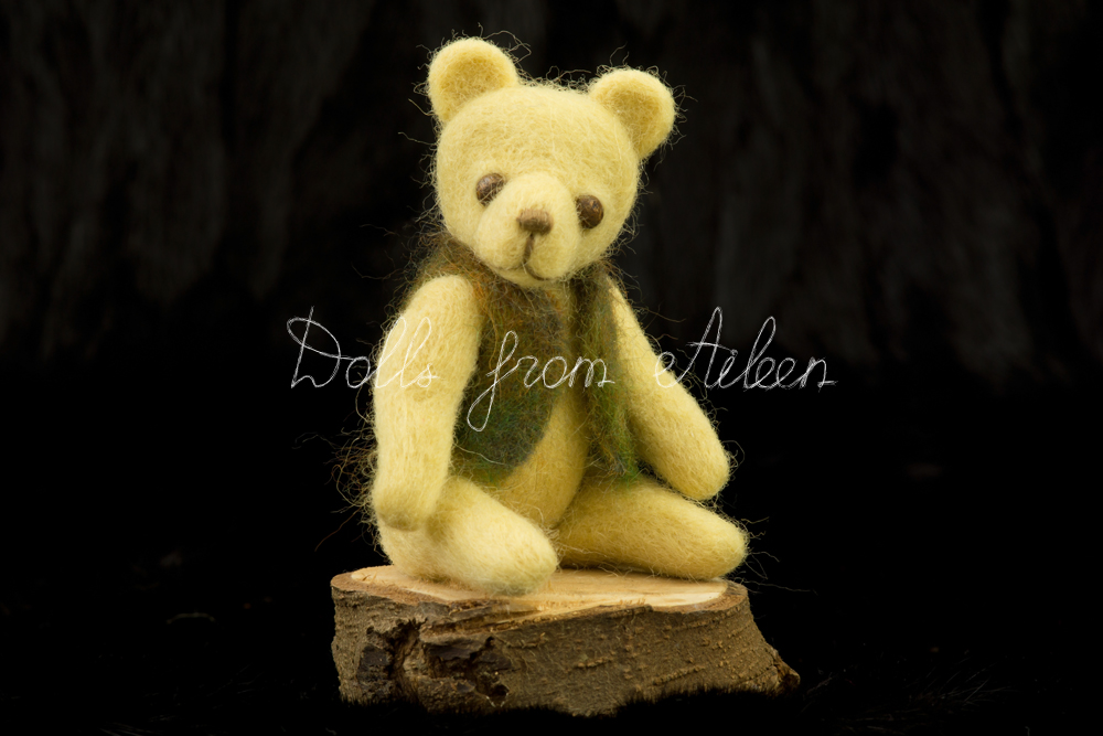 ooak needle felted teddy bear sitting on stump