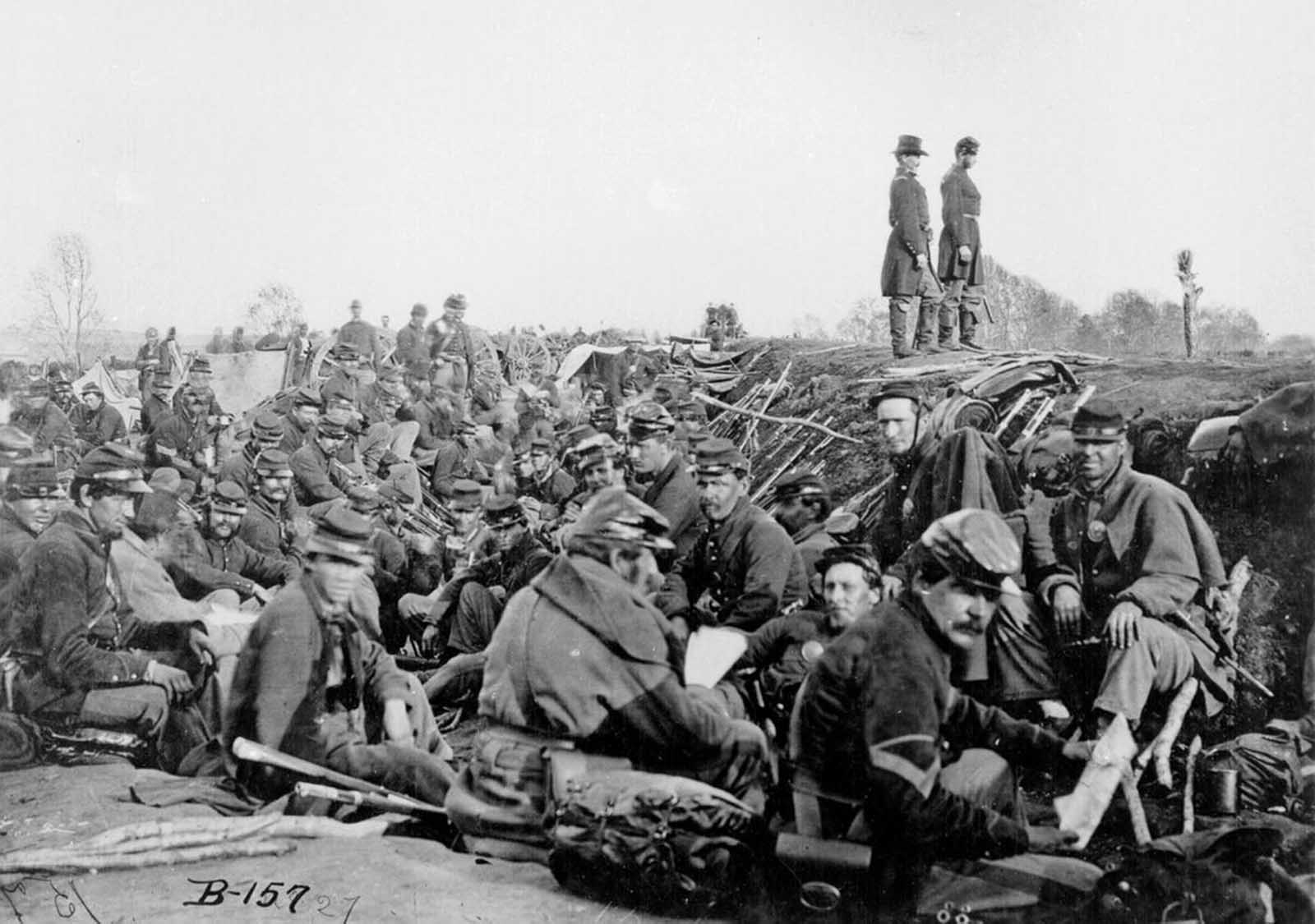 Soldiers of the VI Corps, Army of the Potomac, in trenches before storming Marye's Heights at the Second Battle of Fredericksburg during the Chancellorsville campaign, Virginia, May 1863. This photograph (Library of Congress #B-157) is sometimes labeled as taken at the 1864 Siege of Petersburg, Virginia.