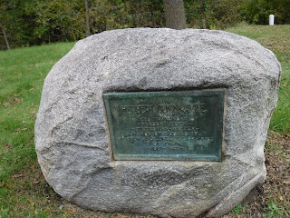 large boulder with green plaque at entrance to Ravine Park in Sioux City, Iowa