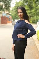 Poojita Super Cute Smile in Blue Top black Trousers at Darsakudu press meet ~ Celebrities Galleries 049.JPG
