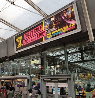 Advertising for Junkyard Golf. Spotted at Manchester Piccadilly railway station