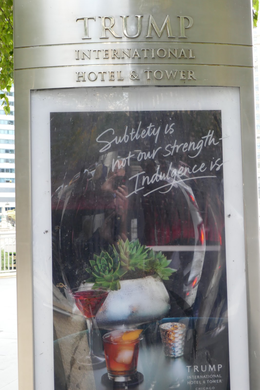 Health Care Renewal Circuit Board Elite Miracle1 Gates Poster Displayed In Front Of Trump International Chicago Hotel Displaying The Slogan Subtlety Is Not Our Strength Indulgence