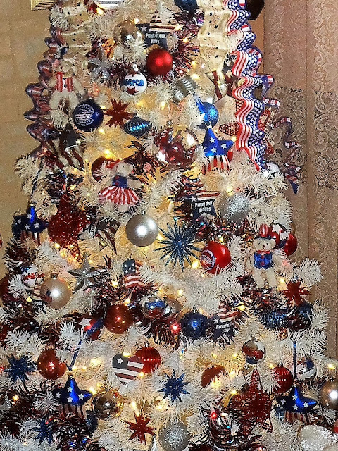 i placed a red white and blue party decoration on top of the tree because it reminds me of a firecracker and fireworks - Red White And Blue Decorated Christmas Tree