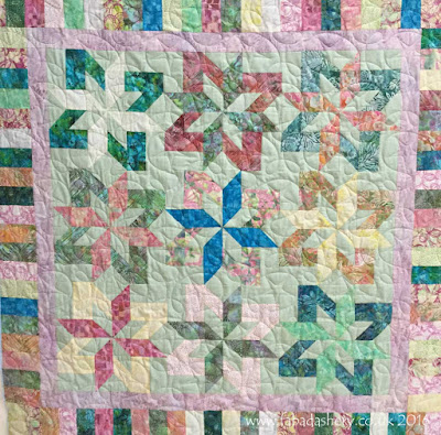 Jelly Roll quilt with 'Ginger Stars' pantograph