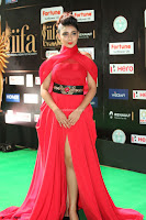 Apoorva in a Stunning Tight Leg Split Sleeveless Red Gown at IIFA Utsavam Awards 007.JPG