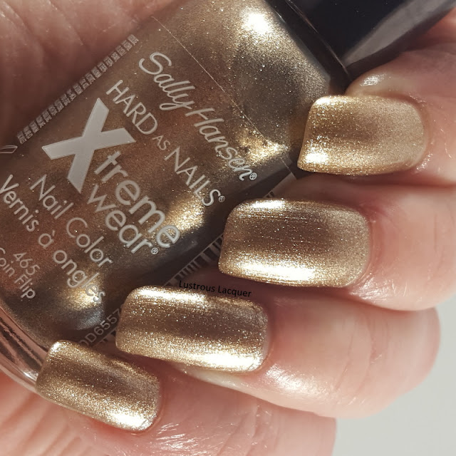 Pale bronze metallic nail polish with golden shimmer