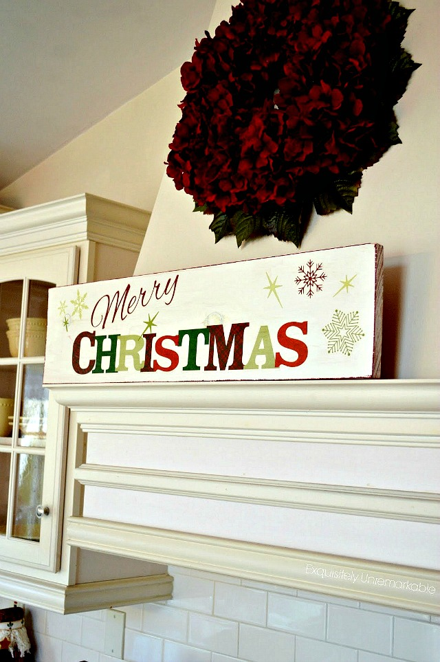 Merry Christmas Wooden Sign on the kitchen hood