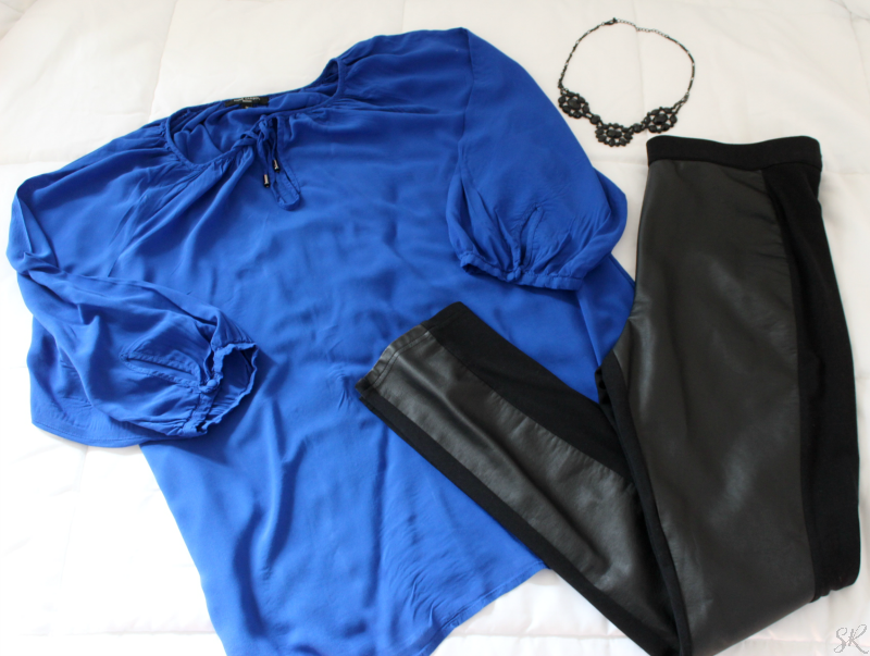 blue blouse with black leather leggings
