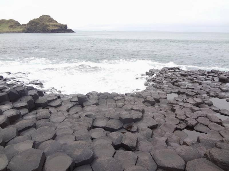 "The formation of Giant's Causeway was due o intense volcanic activity. Lava welling up through fissures in the chalk be formed a ""Lava plateau""."