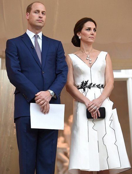 Kate Middleton wore a white dress by Polish designer Gosia Baczynska, and Gianvito Rossi Ankle Strap Suede D'orsay Pumps
