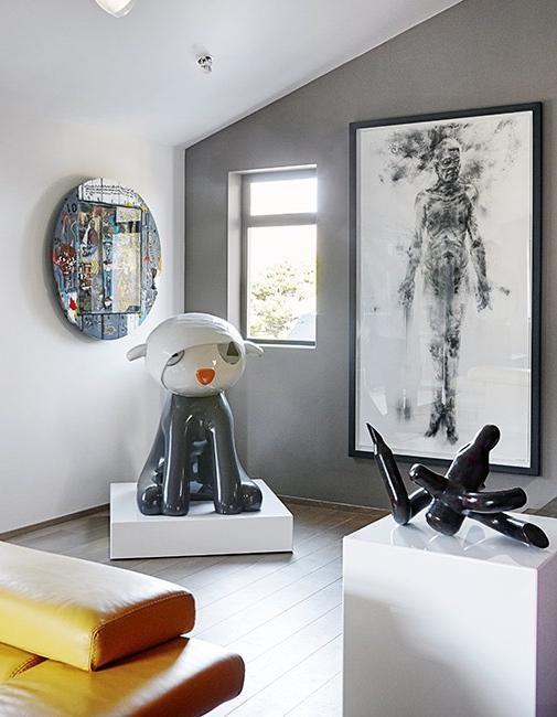 esculturas y grandes lienzos en casa chicanddeco