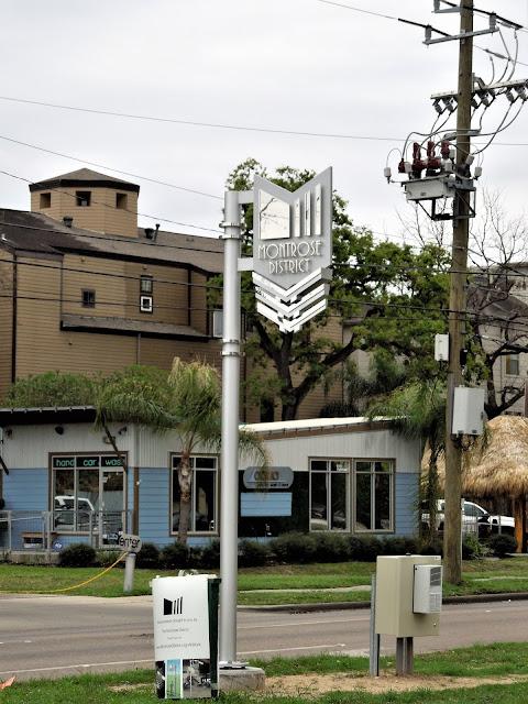 Post-mounted Motrose District signage on Montrose Blvd near W. Dallas Street