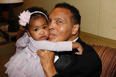 Muhammad ali with his grand daughter.