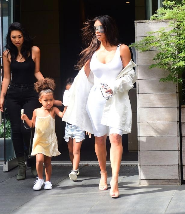 Kim K rocks Men In Black frames as she steps out with North West