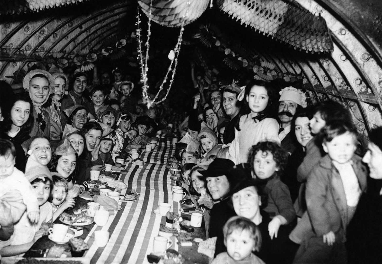 London children enjoy themselves at a Christmas Party, on December 25, 1940, in an underground shelter.