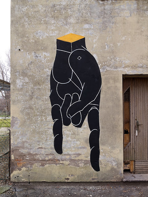 New Hands mural by Italian street artist Basik in the city of Rimini in Italy. 2