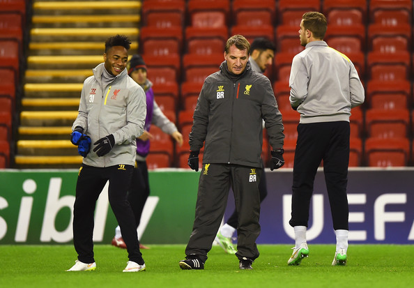 Brendan Rodgers, manager of Liverpool talks to Raheem Sterling of Liverpool during a training session ahead of the UEFA Champions League match against FC Basel 1893 at Anfield on December 8, 2014 in Liverpool, England.