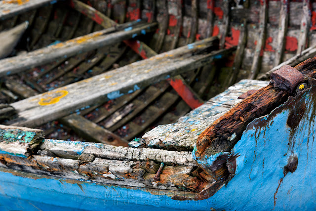 Old boat rotting at Holy Island, Northumberland by Martyn Ferry Photography