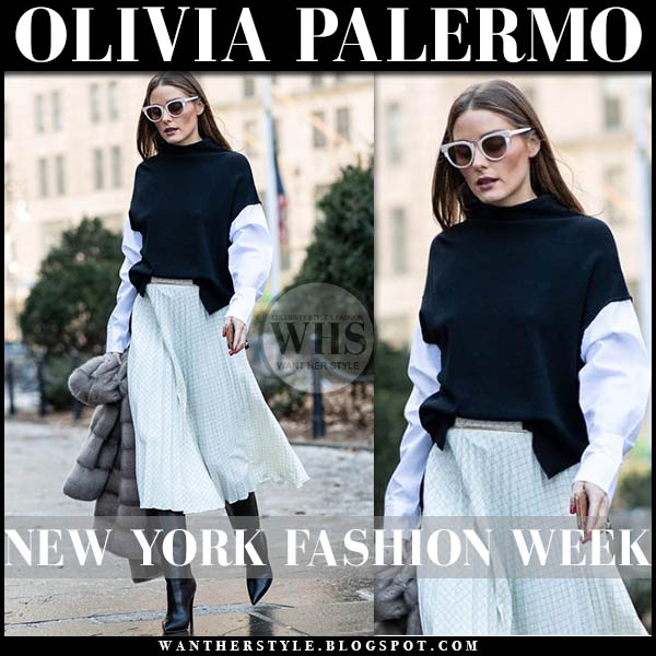 Olivia Palermo in black sweater with white sleeves, pleated midi skirt piazza sempione and black boots new york fashion week outfits february 2019